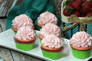 strawberry buttercream frosting recipe with finished cupcakes