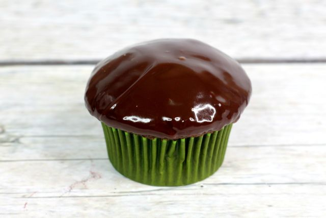 andes mint cupcakes in process dipped in chocolate ganache.