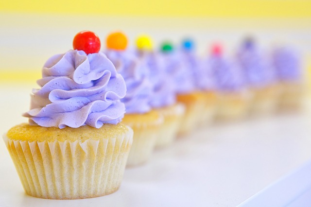 Whipped frosting on purple cupcakes